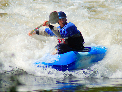 A kayak enthusiast shoots through the rapids on the Delaware River near Washington's Crossing