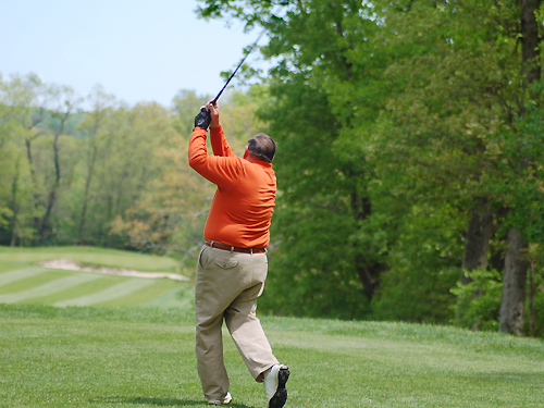 A golfer hits a beauty as he tees off at the Spring Meadow Golf Course near Farmingdale