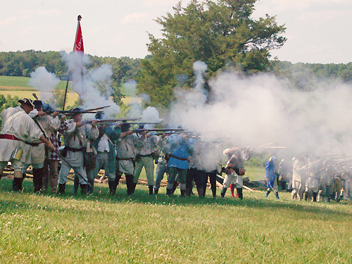 Colonial militia fire a volley at British troops during the annual Battle of Monmouth reenactment near Freehold