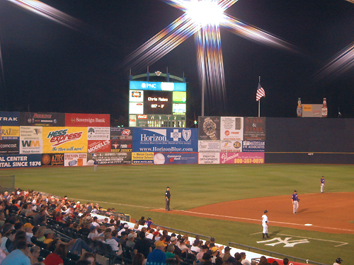 The lights glisten in the night sky at a Trenton Thunder baseball game at the waterfront district