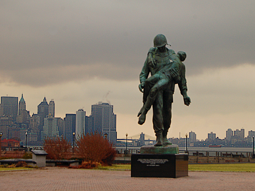 Statue of a WW II GI carrying a concentration camp survivor at Liberty State Park, Jersey City