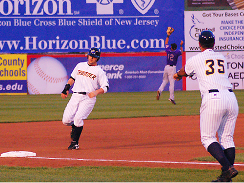 A Trenton Thunder baserunner nears third at Waterfront Park, Mercer County