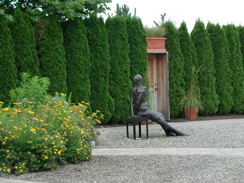 Statue of a young woman resting on bench at the Grounds for Sculpture, Hamilton