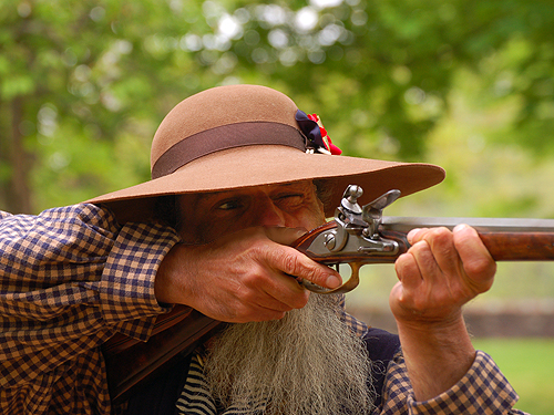 Firing a flintlock during a living history demonstration, Worthington State Forest, Columbia