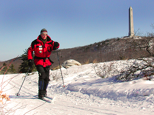 A ski patroller passes by the monument at High Point State Park, Sussex County