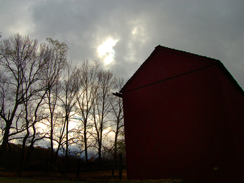 A barn is silhouetted against the winter sky at Jockey Hollow, Morris County
