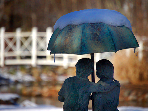 Statue of a young couple overlooks the pond at Sayen Park, Mercer County