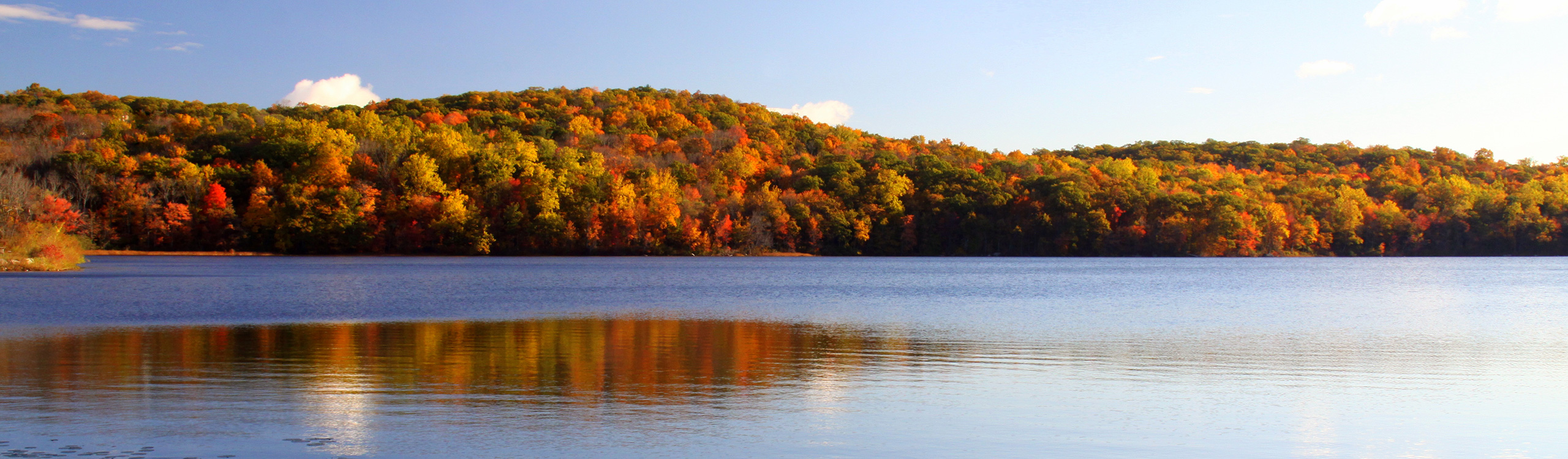 Shepherds Lake Ringwood State Park mountain with fall colors behind lake