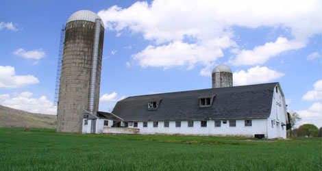 Farm building with tall silo
